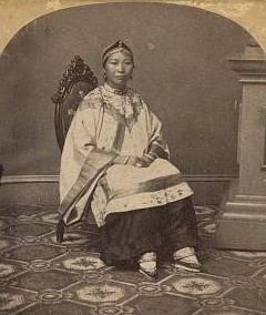 An early photograph of a Han woman wearing leggings and lotus shoes (c. 1865; courtesy of the Library of Congress, LC-DIG-stereo-1s05251).
