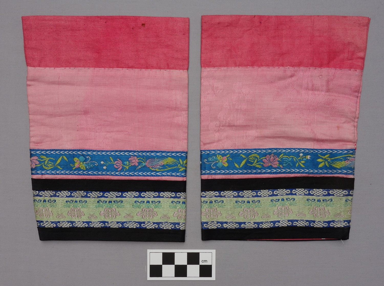 Pair of leggings worn with a pair of lotus shoes (late 19th century; TRC 2013.0063c-d).