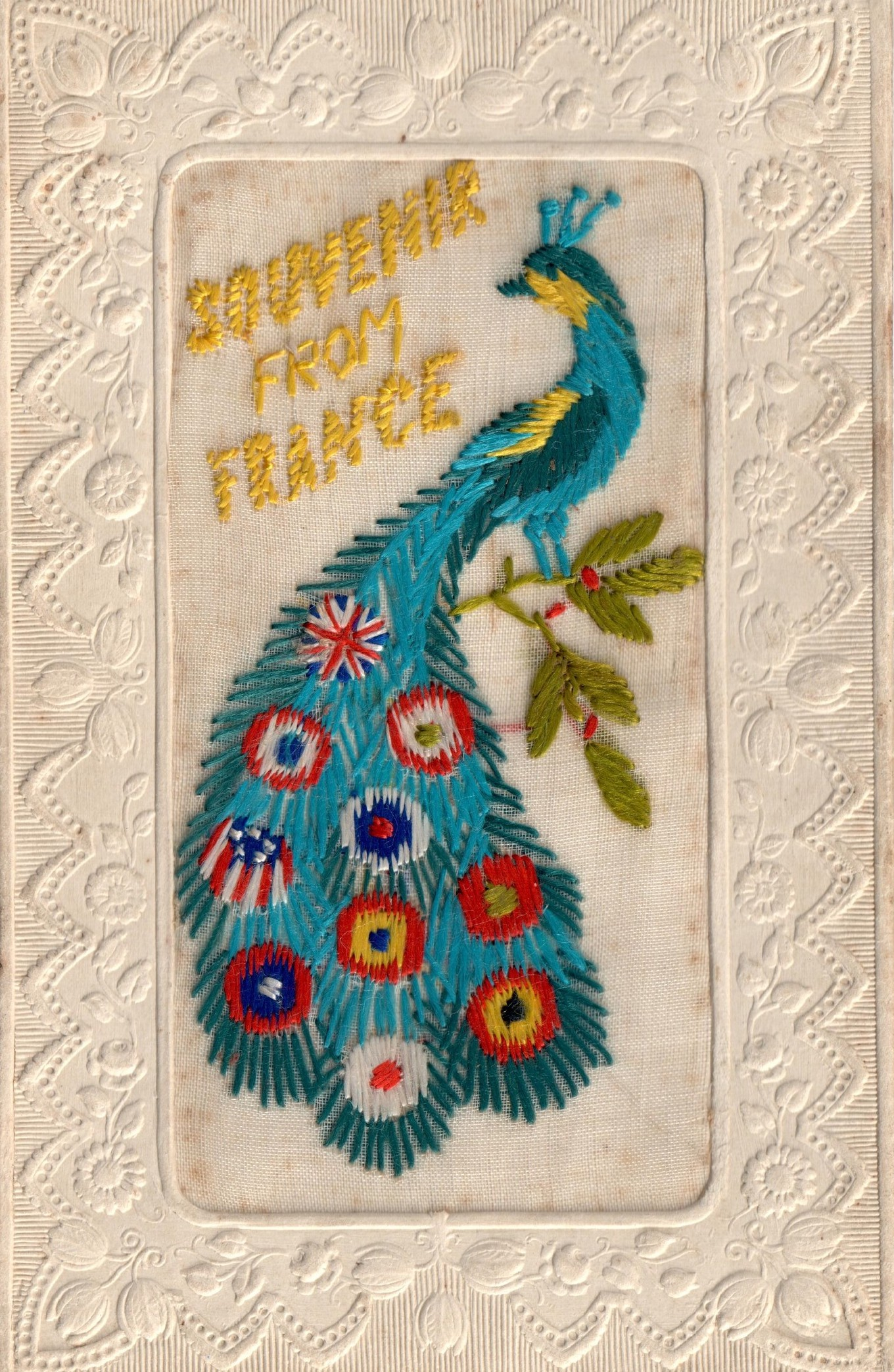 Embroidered postcard from the First World War, with the flags of the Allies depicted on the feathers of a peacock (TRC 2015.0434).