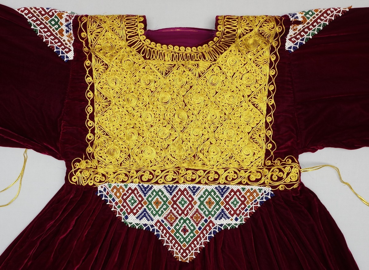 Detail of a velvet Pashtun wedding dress with a chest panel decorated with beading and passementerie (Afghanistan).