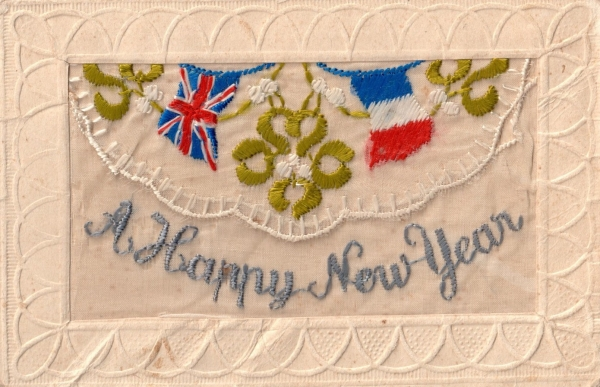 A silk embroidered postcard with the British and French flags.