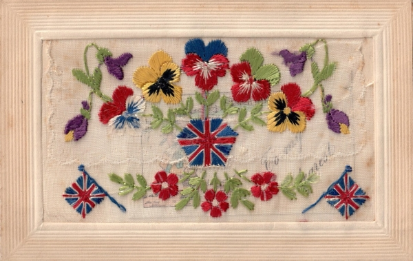 Silk embroidered postcard from the First World War, with pansies and British flags.