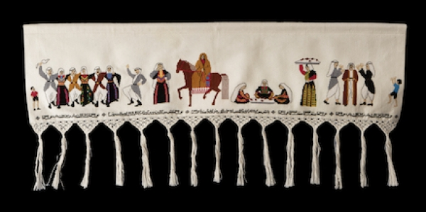Palestinian panel with embroidered depiction of a wedding.