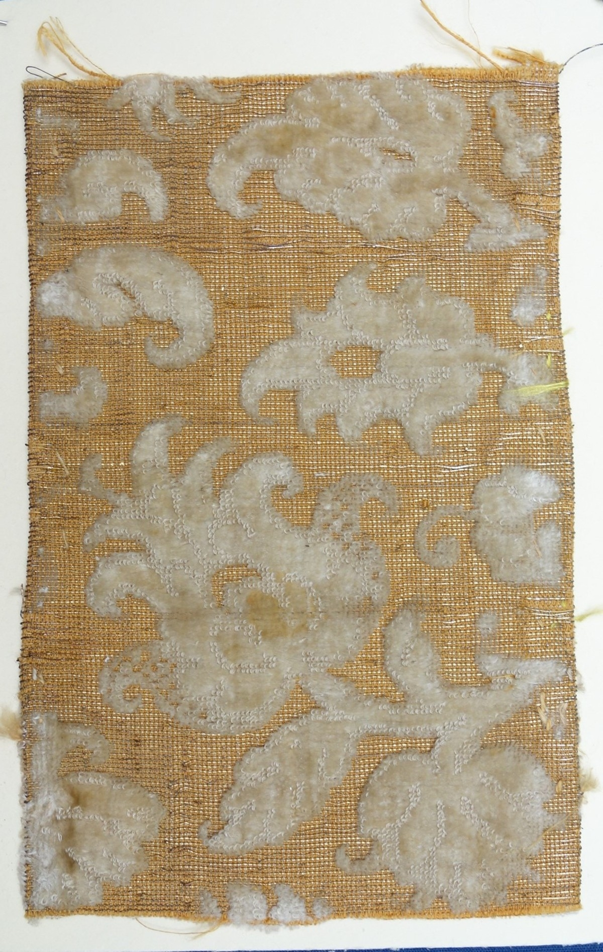 White velvet with metal thread, early 17th century (Europe).
