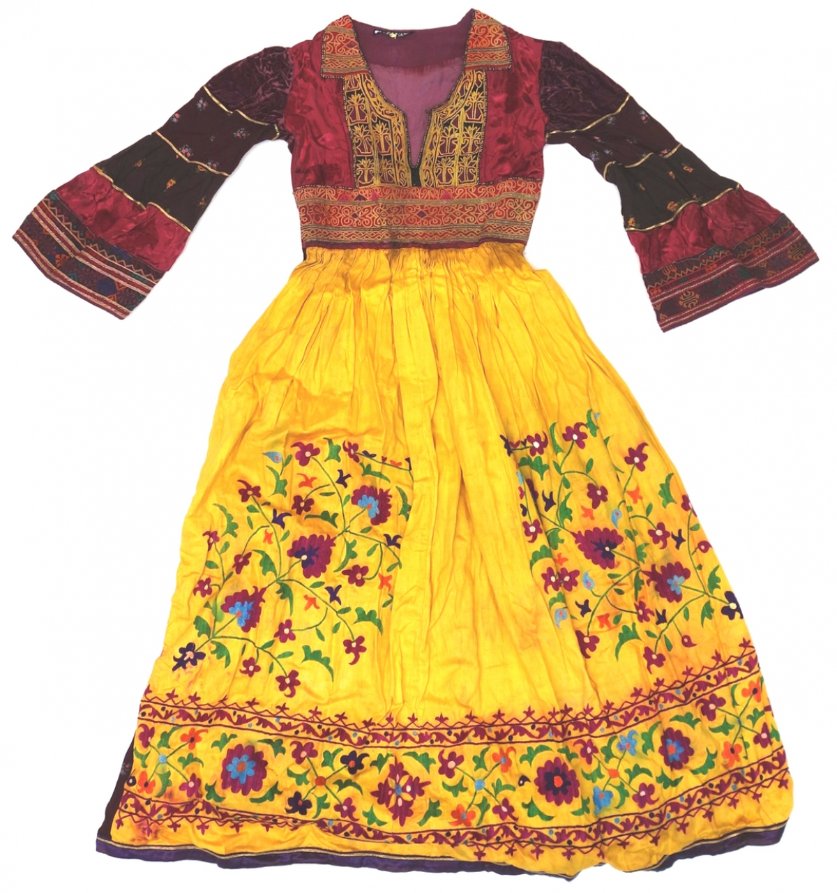 Dress made from an Hazara dress bodice from Afghanistan and a skirt made from an Uzbek suzani (needlework), sold in the 1970s under a Dutch designer's label.