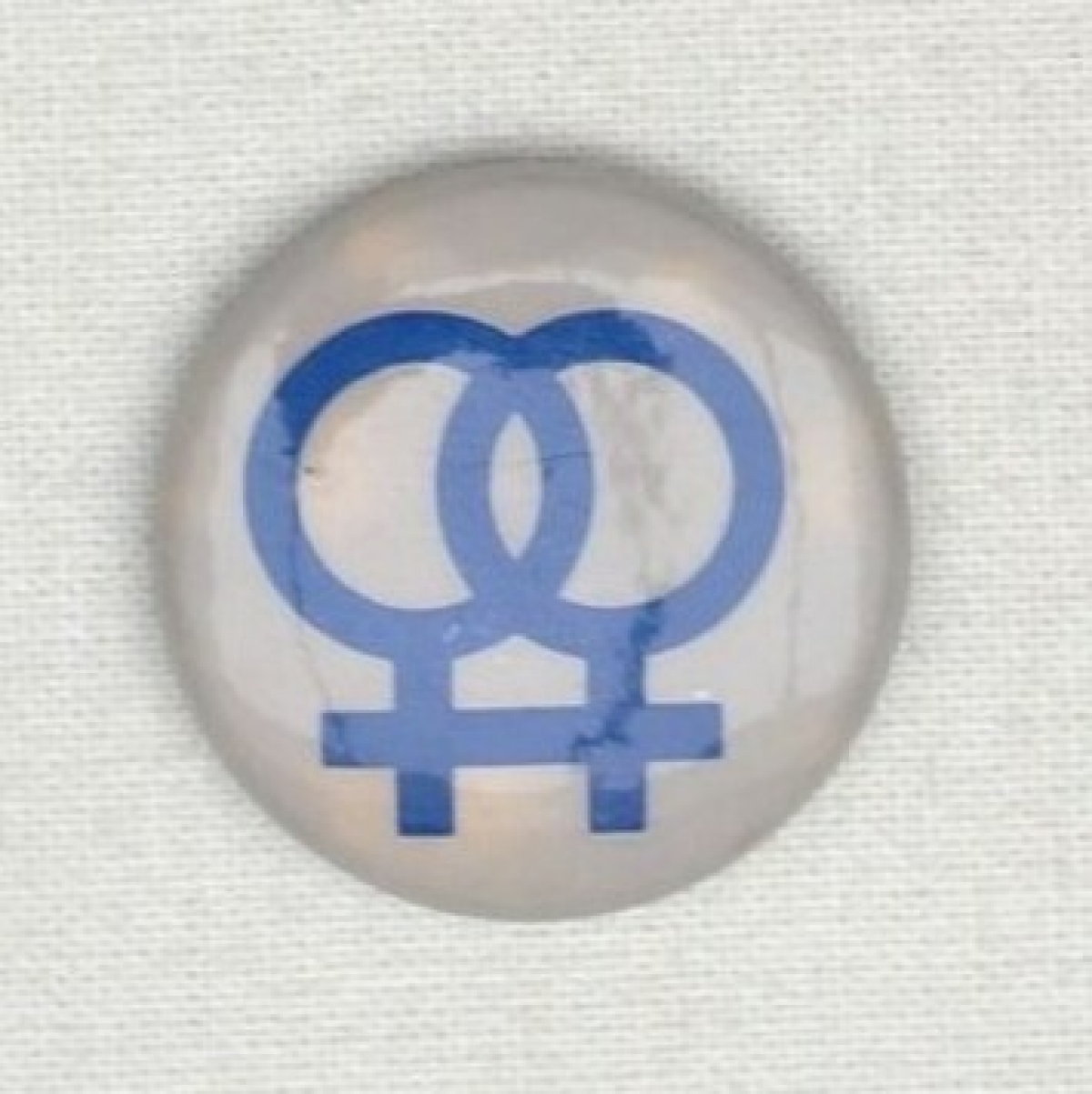 Badge with double women's symbol.