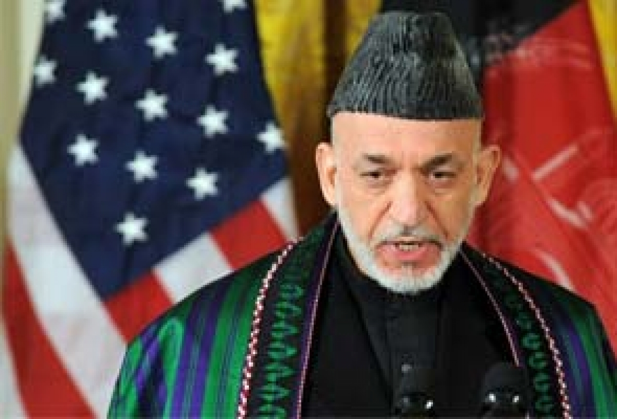 Hamid Karzai, President of Afghanistan 2001 (2004)-2014, wearing a chapan coat and karakuli headdress.