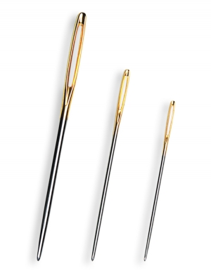 Three examples of a darning needle.