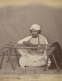 Photograph of an embroiderer in Delhi, c. 1863.