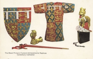 Replicas, made in the 1950's, of the armorial achievements of the Black Prince, including his jupon.