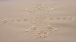 Modern example of eyelet embroidery.