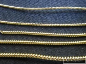 Examples of pearl purl gold work.