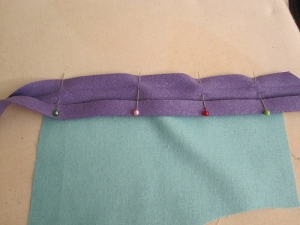 Example of bias binding being sewn onto another textile.