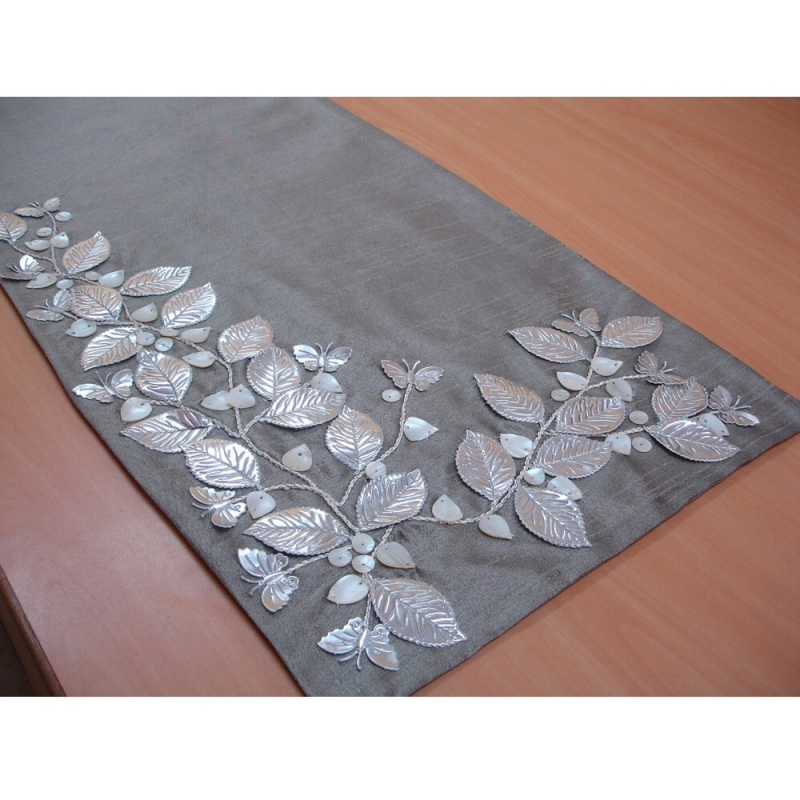 A Table Runner With Embroidery And Applied Mother Of