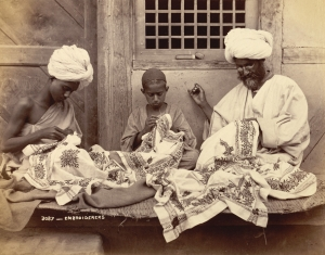 Photograph of three carpet embroiders from Jammu and Kashmir, 1890's.