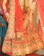 Bridal gagra dress with gotapatti decoration.