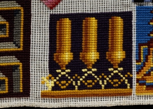 Detail of a 19th century English sampler with gros point stitch.