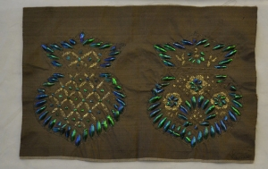 Length of silk cloth decorated with gold wire and beetlewings (19th century, India).