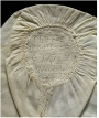 A late 18th century linen child's cap decorated with a band of hollie point