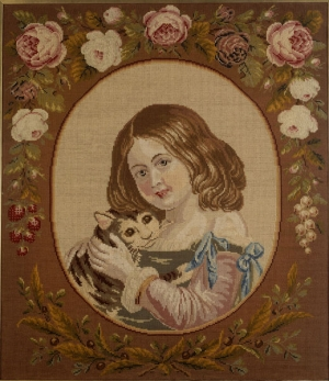 Girld holding a cat. Embroidered picture, Berlin wool work. Britain, c. 1840.