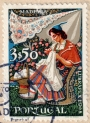 Portuguese postage stamp showing woman from Madeira working her embroidery, 1968.