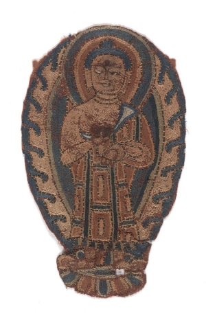 Textile fragment with the embroidered figure of a Buddha. Dunhuang, 8th - 9th centuries AD.