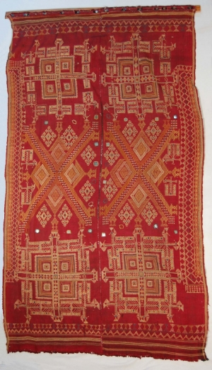 A wedding shawl in red wool with Jat cotton embroidery using cotton thread and mirrors (mid-20th century; Shekawati district, Rajasthan).