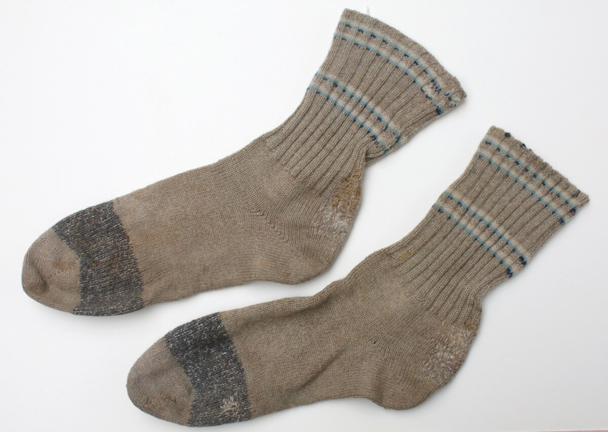 Pair of heavily mended socks from The Netherlands, 1940's (2007.0742).