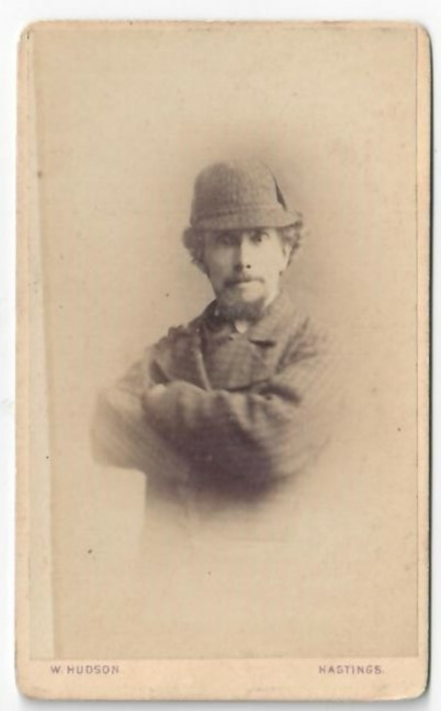 Man with a hat of the deer-stalker type, made popular by Sherlock Holmes. Britain, late 19th century (TRC 2020.3034).