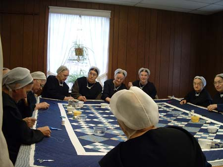 Mennonite women in North America engaged in making quilts, 2005.