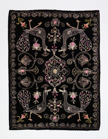 Black velvet bathmat, with an embroidered design of peacocks. Iran, late-20th century (TRC 1999.0266).
