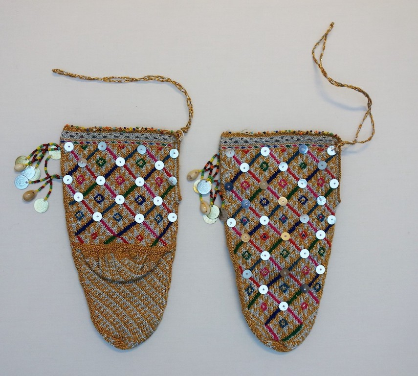 A pair of hand knitted Macedonian bridal socks, late 20th century (TRC 2019.0068a-b).