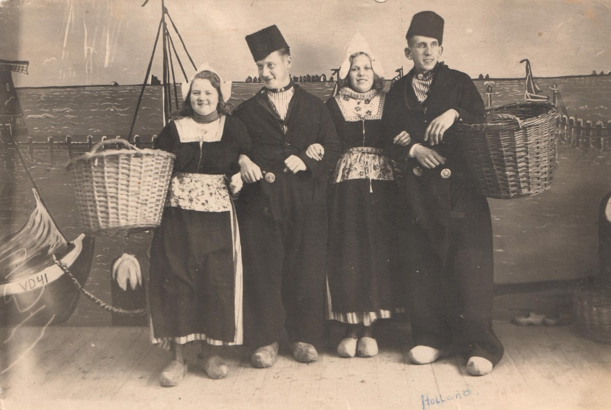 Postcard with two German soldiers and two women in Volendam-style costume, 1943 (TRC 2019.1436).
