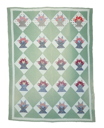 Early 20th century American quilt, with a block design of Cactus Basket or Desert Rose. TRC Collection (TRC2019.2041).
