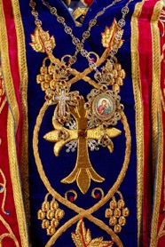 Episcopal cross and medallion on top of embroidered liturgical vestment. Photograph by Joost Kolkman, Voorschoten.