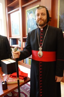 Bishop Polycarpus with a bishop's medallion and walking staff (photograph by Gillian Vogelsang-Eastwood).