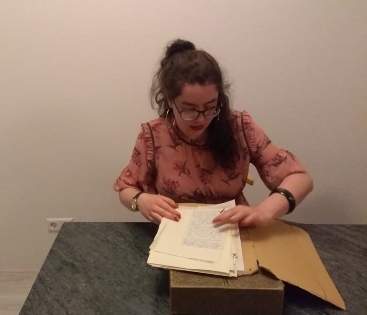 TRC volunteer, Alice Jaspars, studying the Robert Charleston correspondence housed in the TRC library (February 2019).
