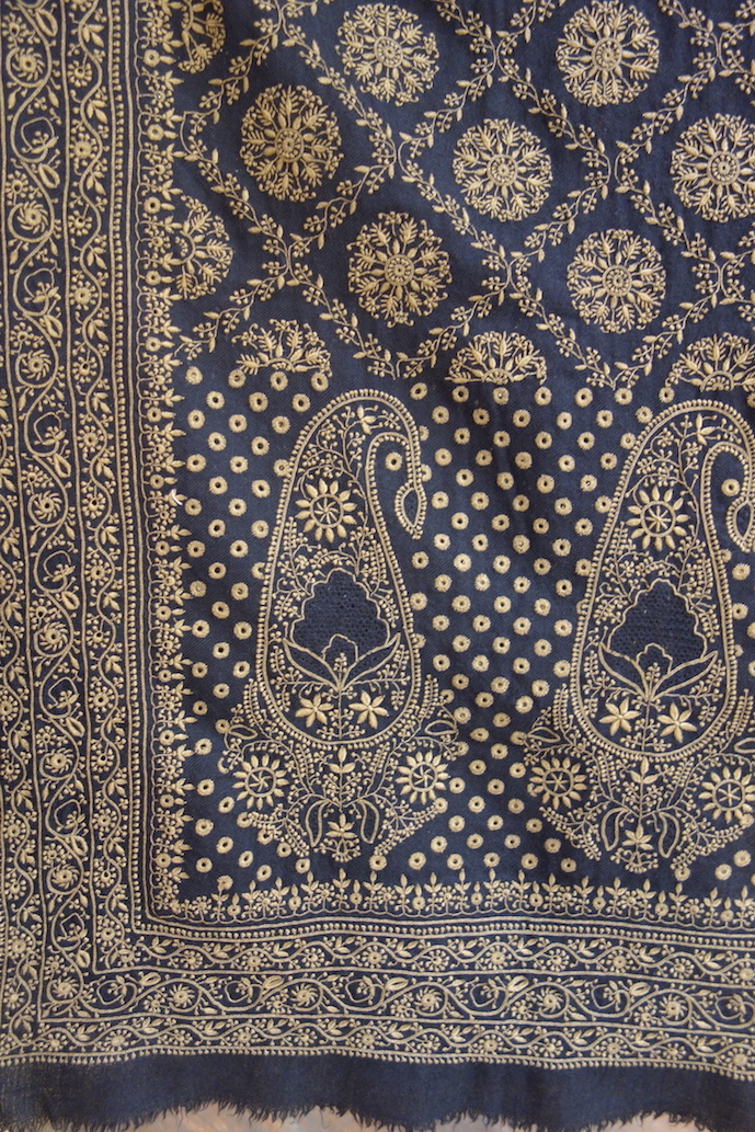 Detail of a pashmina shawl decorated with chikan embroidery, Lucknow, India (photograph 27th July 2017).