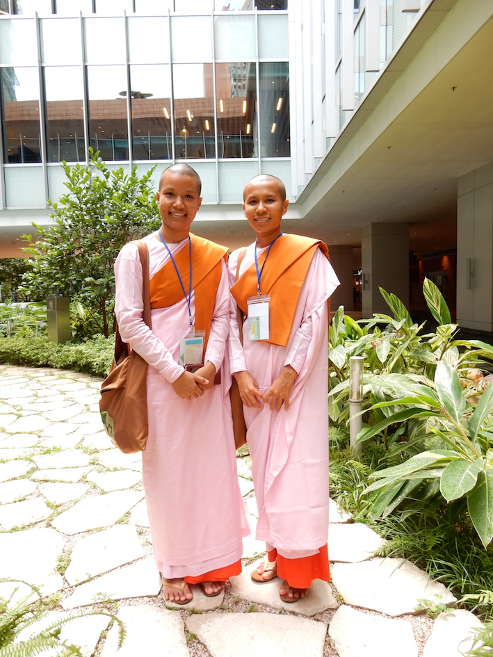 Two Buddhist nuns in pink. Photograph by Shelley Anderson.