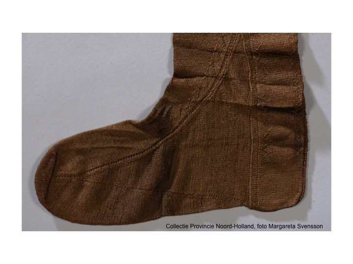 Foot of 17th century silk stocking from Texel.