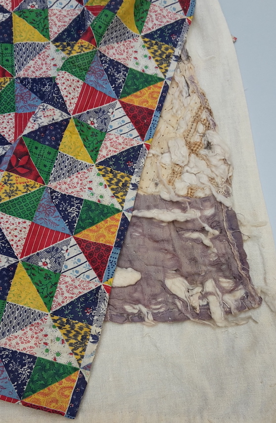 Early 20th century American quilt, with a mid-19th century quilt hidden inside.