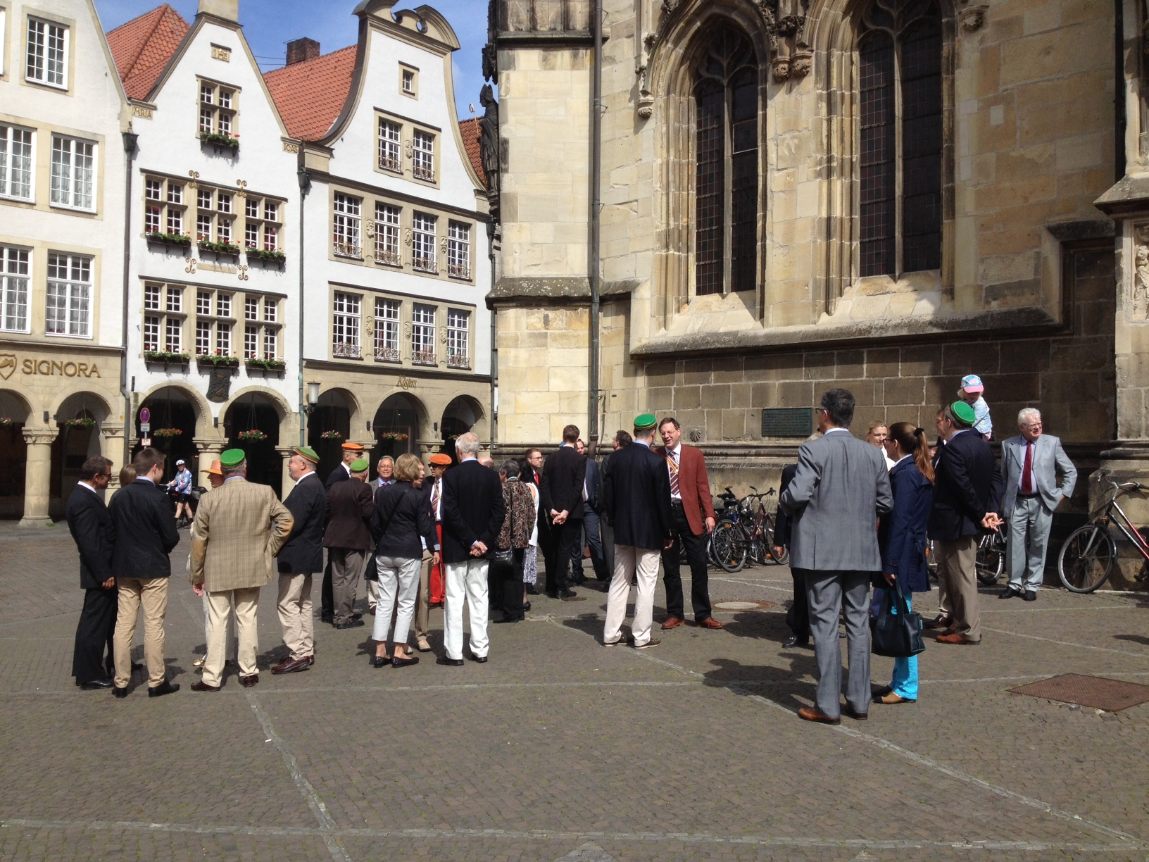 Group of (ex)students with their Mütze (cap) in front of the Lambertikirche, Münster, Germany, 24 May 2015