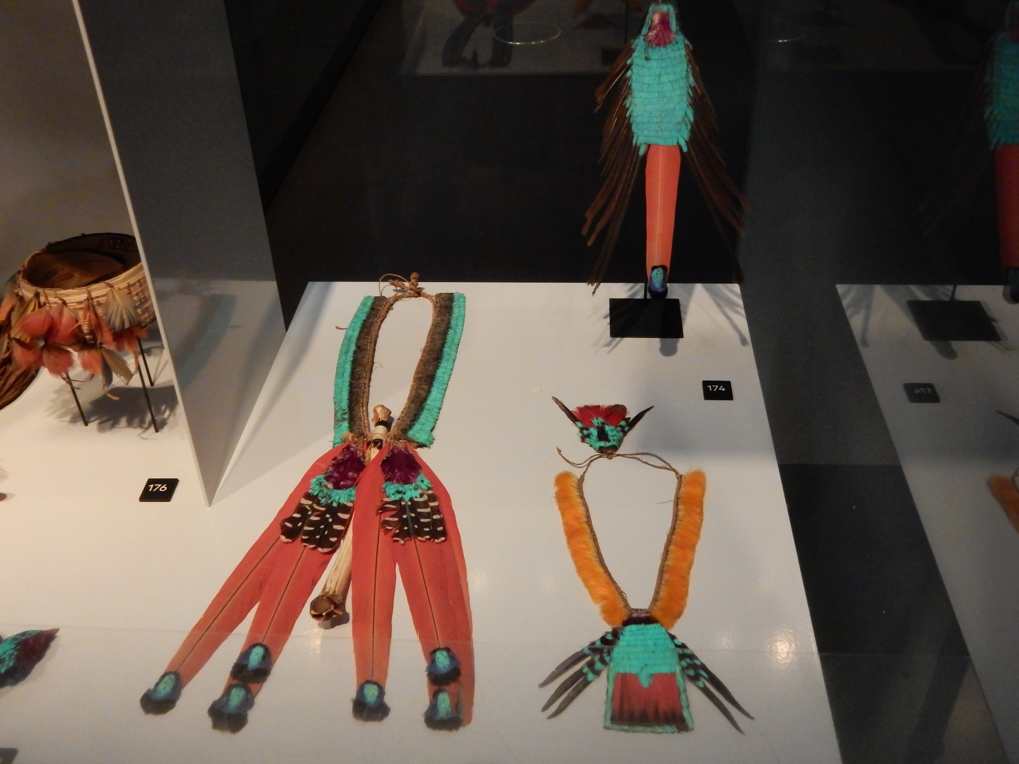 "Showcase with feather jewellery from Brazil, in the exhibition ""Jewellery: Made by, worn by"", in the Volkenkunde Museum, Leiden. Photograph: Shelley Anderson."