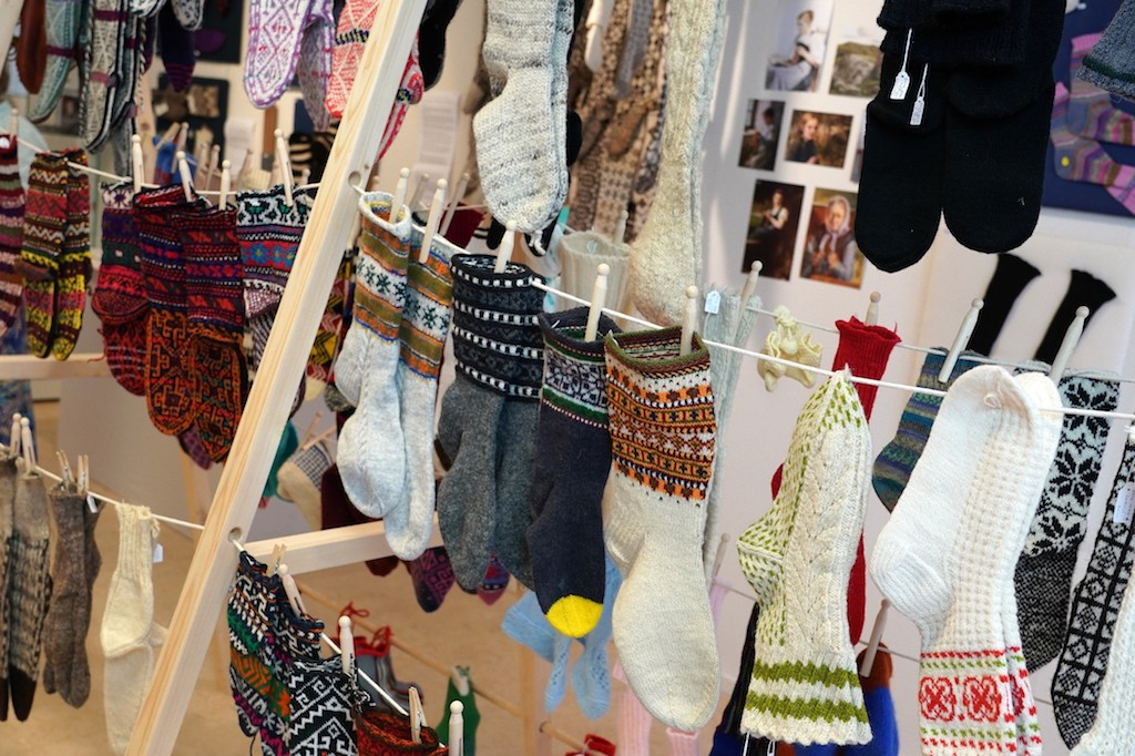 Rack of hand knitted socks from around the world. Socks&Stockings exhibition, TRC, 2019. Photograph by Joost Kolkman.