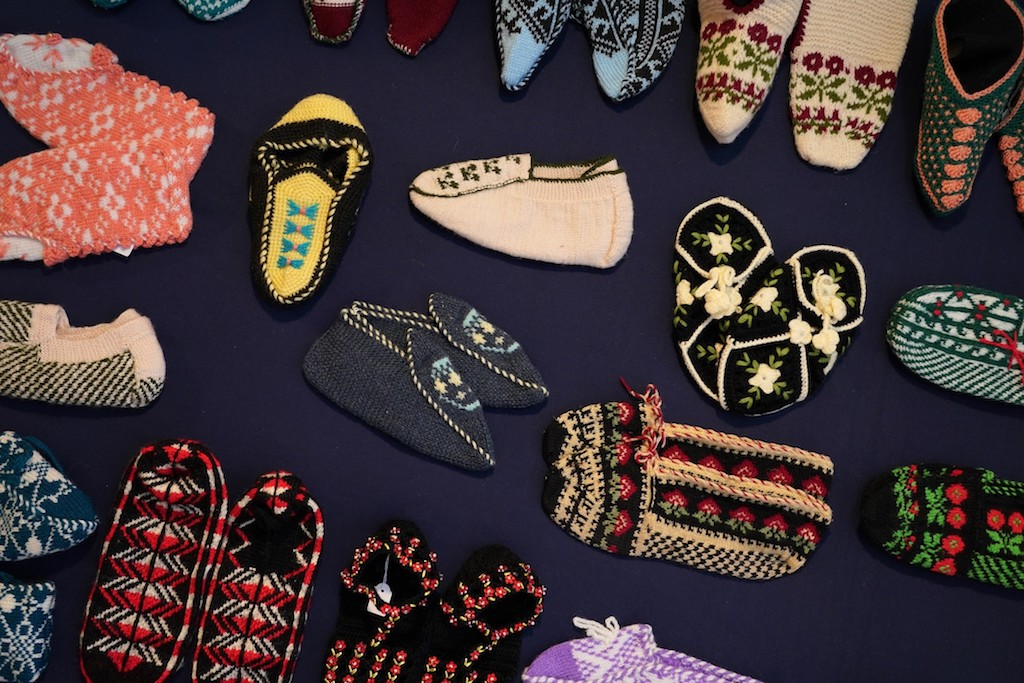Selection of Turkish hand knitted slippers. Socks&Stockings exhibition, TRC, 2019. Photograph by Joost Kolkman.