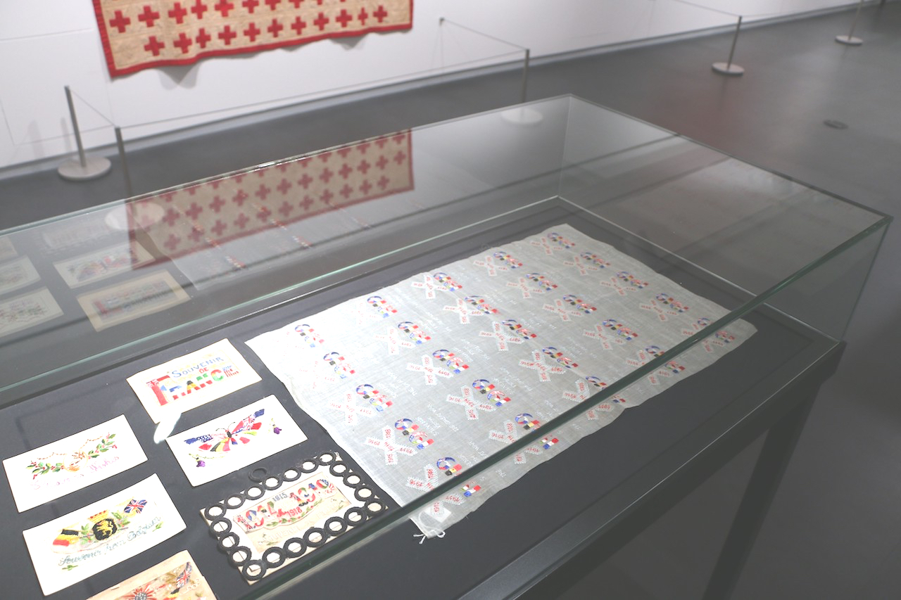 TRC sheet of embroidered designs for WW1 postcards, on display in Kansas City (TRC 2015.0422).