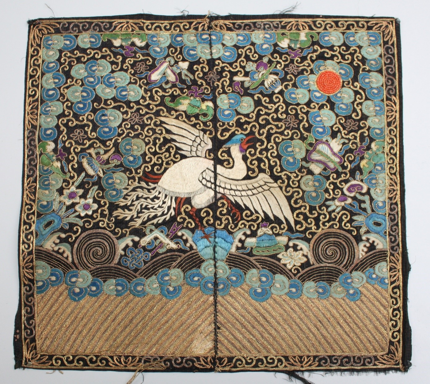 Embroidered rank badge from 19th century China (TRC 2010.0139b).