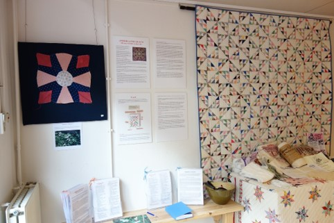 Exhibition starts with the quilt block ' Dutchman's breeches', to the left. The quilt to the right is called 'Birds in the Air'.