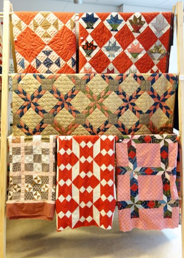 A selection of quilts and quilttops from the 1880's and 1890's.