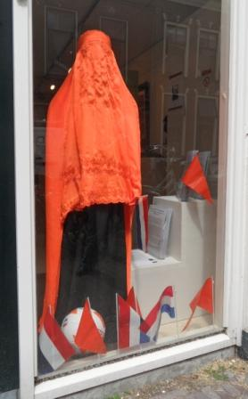 Football is everywhere. A bright orange burqa from Afghanistan in the TRC window